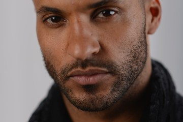 PARK CITY, UT - JANUARY 20:  Actor Ricky Whittle poses for a portrait at the photo booth for MSN Wonderwall at ChefDance on January 20, 2013 in Park City, Utah.  (Photo by Michael Buckner/Getty Images for Wonderwall)