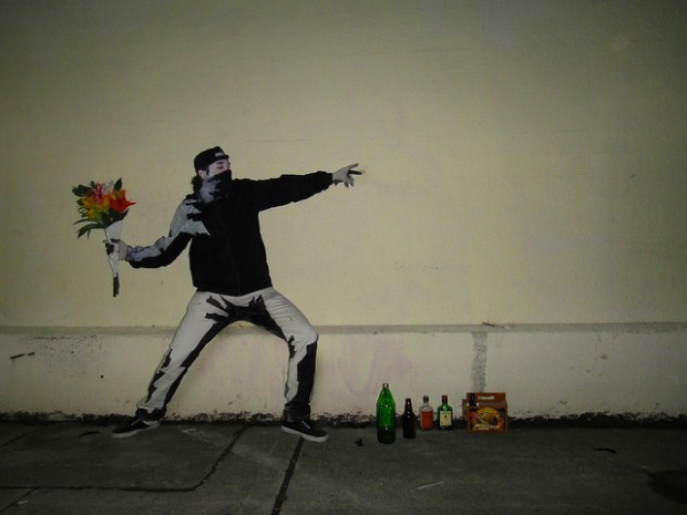 White pants, black hoodie, black and white paint, and a bouquet of flowers and you have yourself a hipster-worthy [Amazing Bansky costume](http://blog.makezine.com/craft/amazing_banksy_flower_thrower-2/).