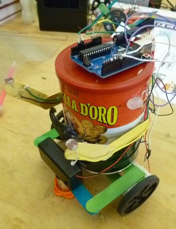This coffee can robot steers itself using light sensors and LEDs. Keep an eye out for this little guy in the magazine.