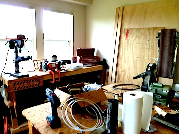 Here is the woodshop at MAKE Labs, complete with a sander, rotary grinder, drill press, and all sorts of hand tools. Not pictured are a table saw, chop saw, and band saw -- most anything one would need to do any non-digital fabrication with wood.
