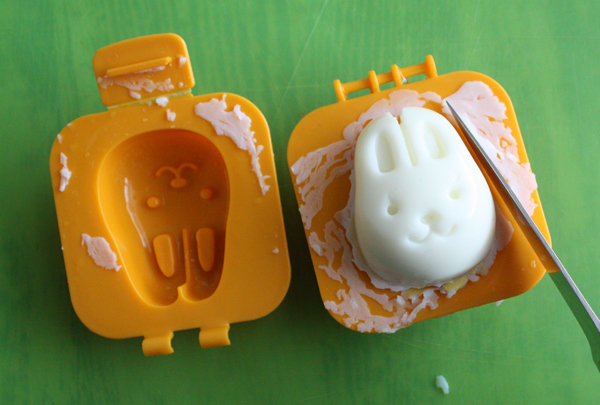 If you're packing for an Easter picnic, shape your hard boiled eggs to look like a bunny face, using a bento egg mold.