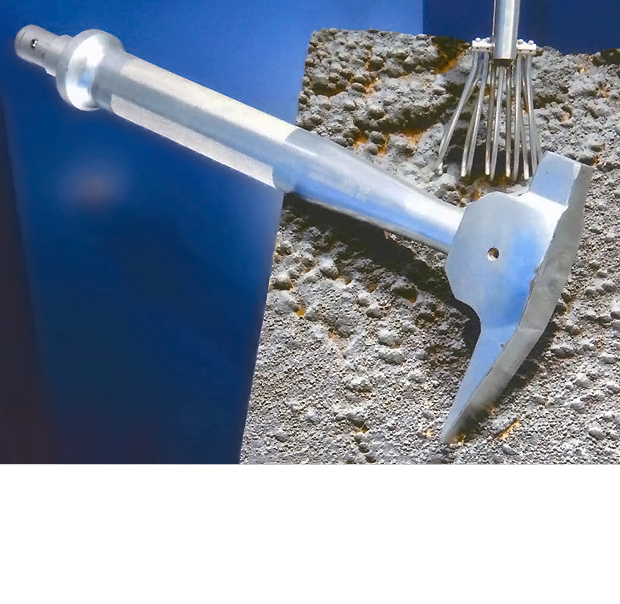 One of several designs for lunar rock sampling hammers featuring a socket and ball-detent on the pommel for attaching an extension tube. So extended, it could be used for scratching furrows in the surface. (link)