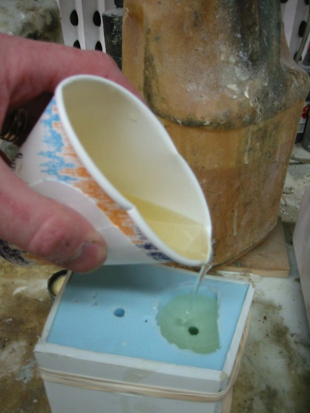 Fig. Q: Pouring the resin.