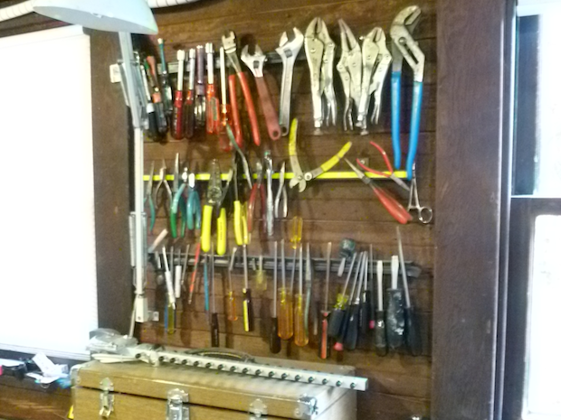 Cliff's hand tools are neatly stowed and accessible on magnetic strips.
