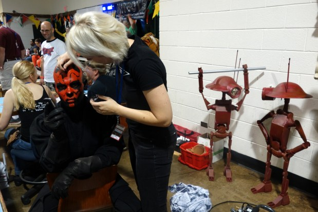 Applying makeup to Darth Maul. The process takes around one hour.