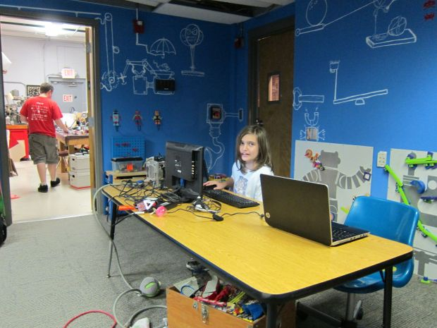 Some artists from Springfield's SquidFoo makerspace came through and painted a beautiful and fun Rube Goldberg machine mural in the kids' room.