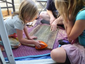 The grip for the sander is made of a soft foam material-- easy on young hands.