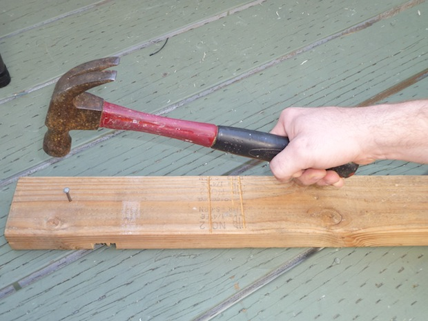 Once you have the nail set, keep your hand around the bottom of the handle. Not only is it more stable, but gives you the most leverage when hammering.
