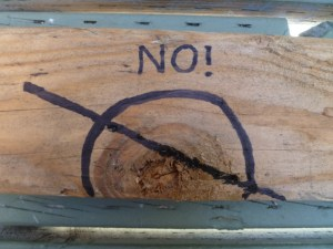 Not only are knots denser than the surrounding wood, but they're also more prone to splitting. Avoid them if you can.