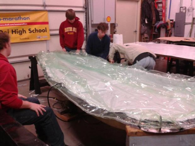 After applying the last layer of carbon fiber, the shell is placed in a vacuum sealed bag.