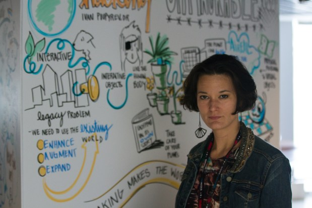 "Heather in front of a graphic she drew for Ivan Poupyrev's talk on ""Hacking the Unhackable"" on Saturday."