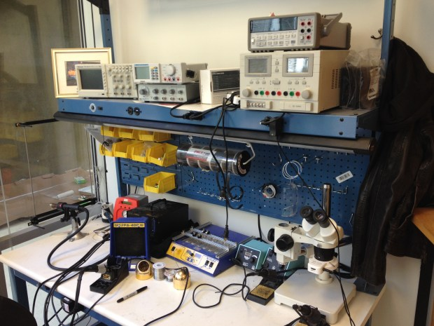 A well-stocked electronics bench with some new Hakko tools.