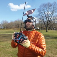 "Georgi Tushev's head-mounted FPV ground station sports a large flat high-gain ""patch"" antenna."