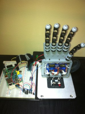 "A Raspberry PI monitors the tweets to @OurCatDoor. The PI's GPIO acts as inputs to a PICAXE 18M2 which controls servos on a robot hand. If your tweet includes any of the text below, the ""Hand of PI"" obeys your command. Valid commands are (lowercase): one (holds up one finger); peace (peace sign); three (three fingers); hookem (Texas Longhorn fan); fist (ready to fight); open ('high five'); finger (well… this will be the most tweeted command)  Project Link"