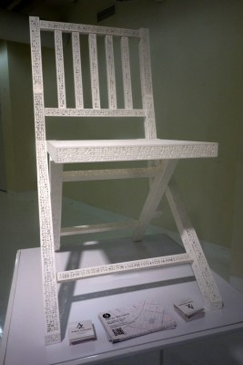 The chair's structure is a code, which if scanned with the correct decoder would tell a computer, 'chair.'  See next slide for detail shot.