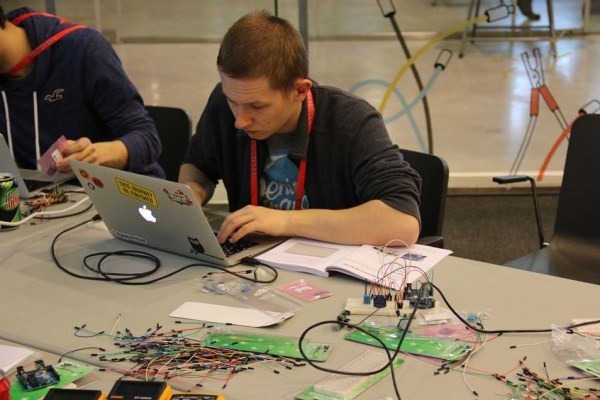 "In the ""Python and Ruby Sitting in a Tree"" workshop, attendees programmed an Arduino to interact with sensors such as the DHT11 temperature and humidity sensor, the VCNL4000 light sensor, the HC-SR404 ultrasonic ranging module, and the HC-SR501 PIR sensor module."