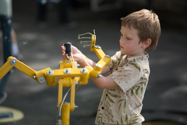 A young maker investigates the workings of a Poseables life-size mannequin at Maker Faire.