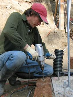This is a photo of myself using a drill I inherited from my grandfather. A steel 'made in America' model, although not sure of the manufacturer. The photo was taking in 2005 during the construction of our home. The drill did not make it through the build, but I have fond memories drilling out the sill plates for the anchor bolts and do remember thinking of my grandfather as I did so.  - Aaron Coates