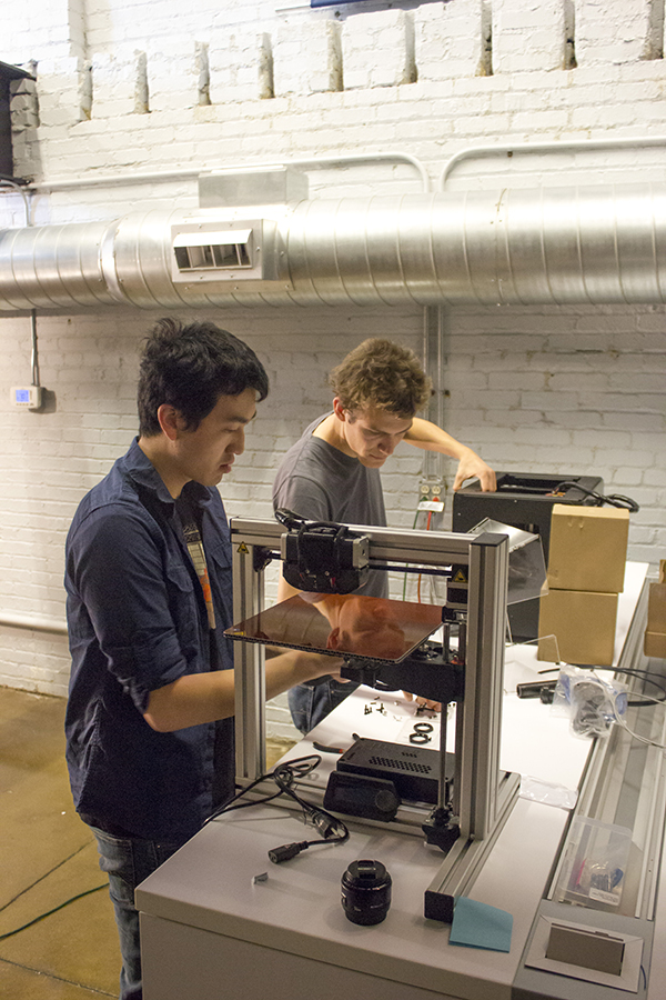 Eric Chu and Andreas Bastian set up two of our 23 printers.