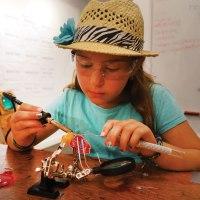 student-soldering