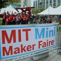 The MIT Mini Maker Faire filled three circus tents on the MIT campus in Cambridge. That's the organizing team in the red shirts, waving. (photo: Joshua Ramos)