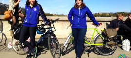 Miriam Engle and Madison Worthy in Copenhagen with refurbished bicycles.