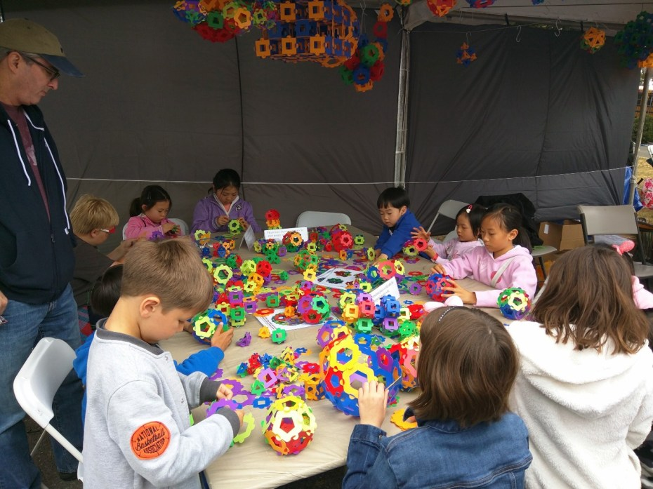A typical activity at Maker Faire. Look at how focused the kids are. I hope parents are learning from this experience to create these opportunities at home.