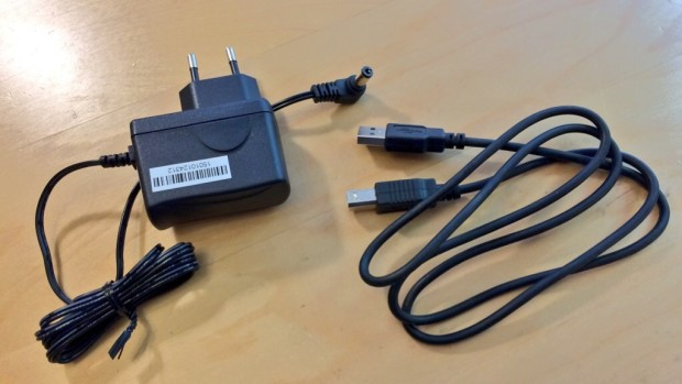 The 5V power supply and a spare USB cable.
