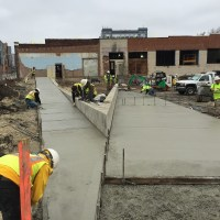 Finished sidewalks up to the main entrance.
