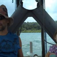 Jaimie and his daughter traveling between their islands.