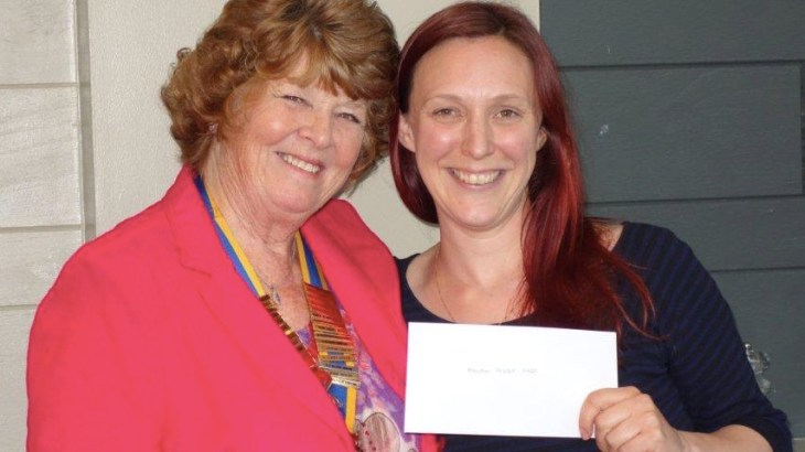President Jenny presenting Katie with a cheque for Malawi Foster Care