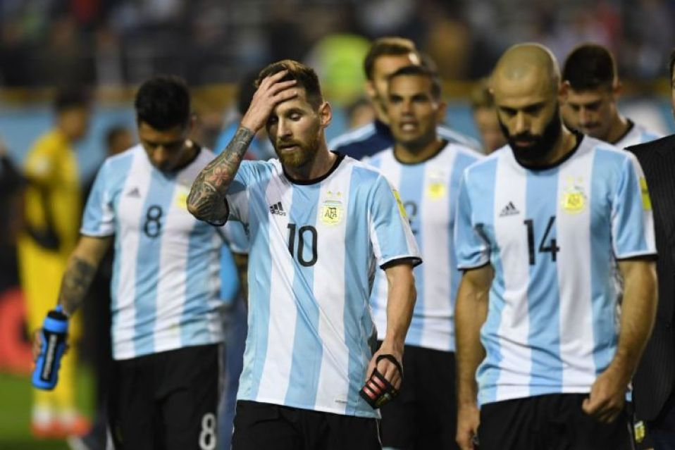 Argentina's Lionel Messi (C) gestures at the end of the goalless 2018 World Cup qualifier football match against Peru in Buenos Aires on October 5, 2017. / AFP PHOTO / Eitan ABRAMOVICH (Photo credit should read EITAN ABRAMOVICH/AFP/Getty Images)
