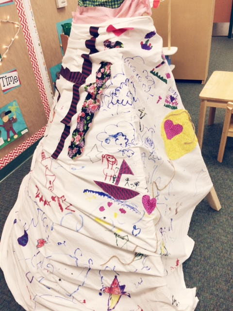 Use markers and fabric scraps to make a cooperative teepee for your classroom library.