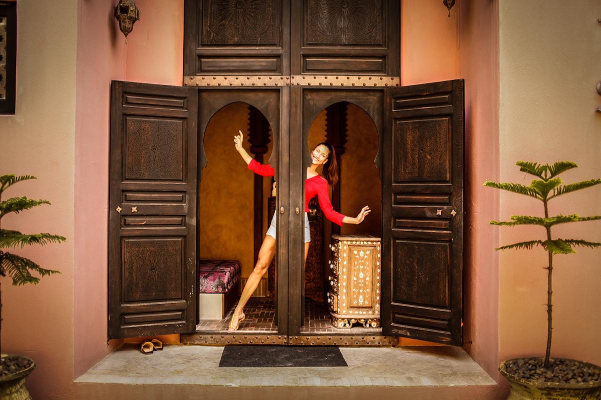 girl dancing in villa maroc pranburi. girl wearing a red blouse.