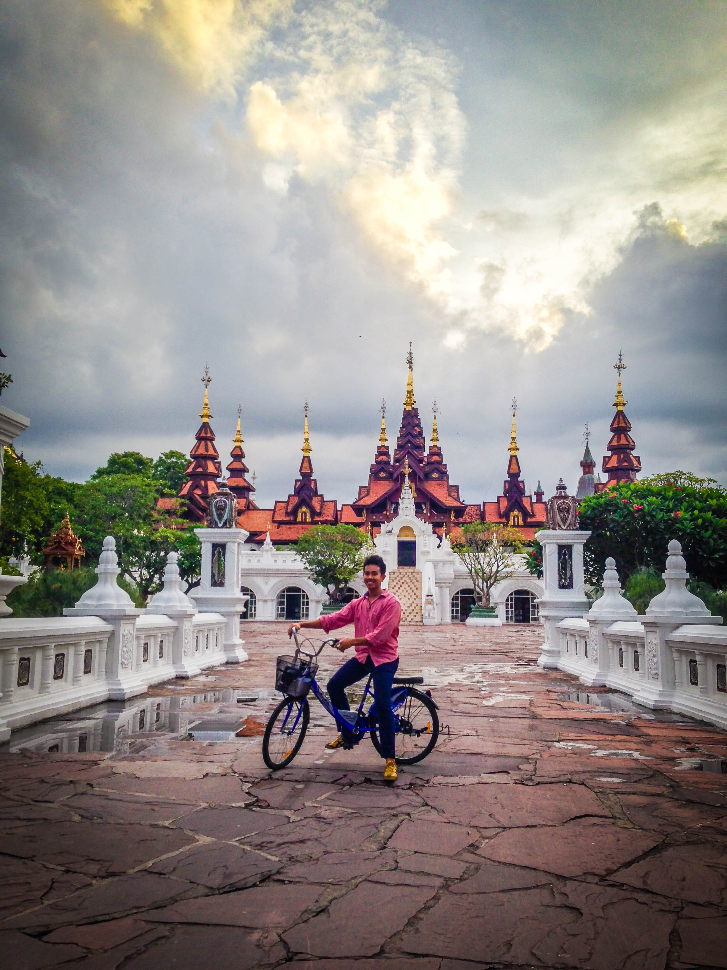 guy on a bike in front of entrance dhara dhevi