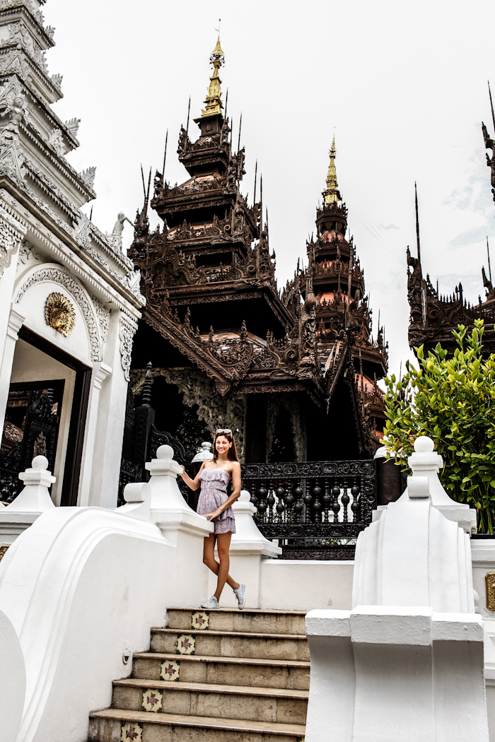 girl wearing summer dress in the stairs of dhara dhevi chiang mai