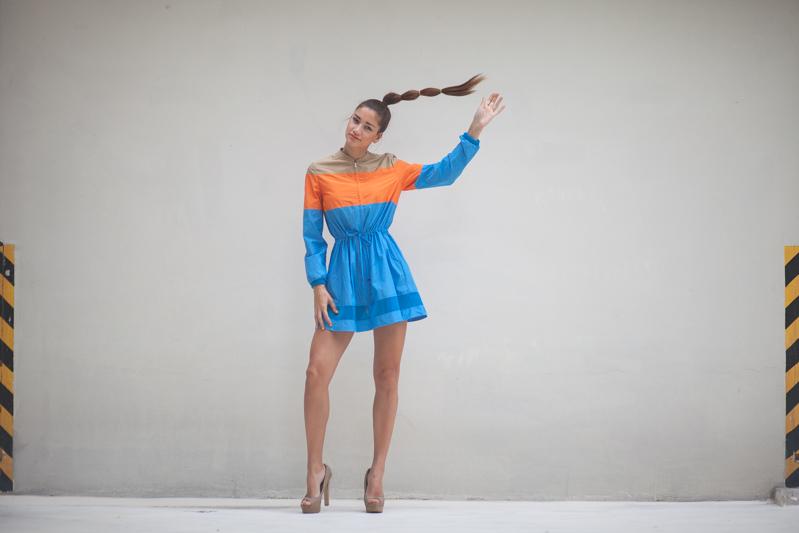girl wearing colourblock dress in parking lot