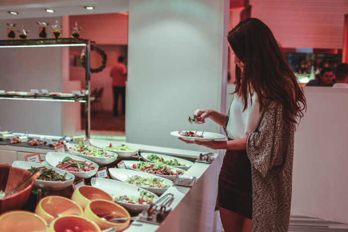 girl standing at food buffet