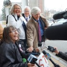 Linda Horan is pictured with her attorney Paul Twomey and friends outside Merrimack County Superior Court in Concord.