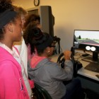 Genesis Gomez keeps both hands on the wheel during the Road Code simulator test.