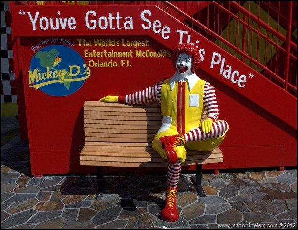 Ronald McDonald on park bench outside World's Largest McDonald's, Orlando, Florida Aeroplan Welcome Aboard Event