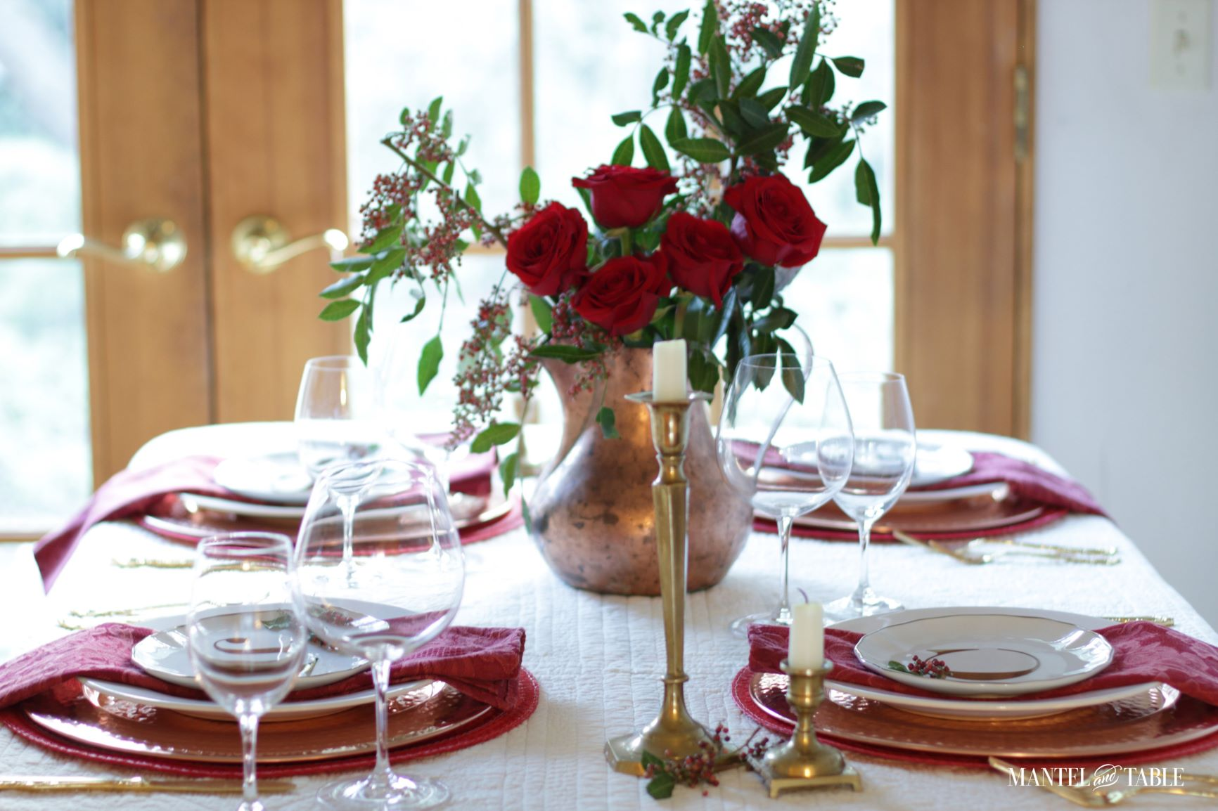 A Christmas Tablescape With Roses And Pepperberries