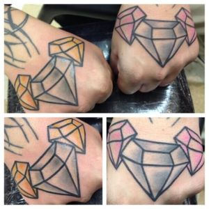 Hand tattoo by Jen