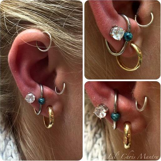 Lower conch with a teardrop captive ring by Lil Chris
