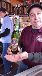Brett being so kind to model with our TsingTao!