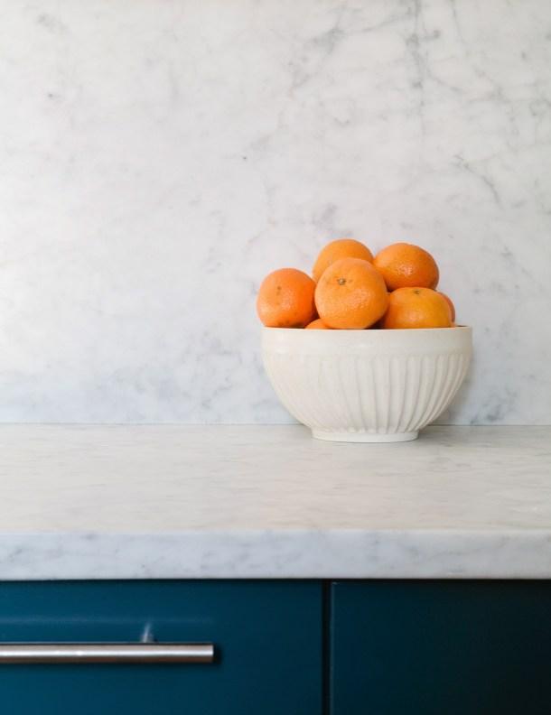 Marble Backsplash and Blue Cabinets