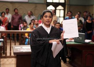 Actress Renuka Shahane as lawyer - Janiva Marathi Movie Still Photos