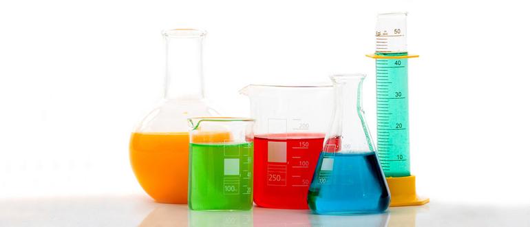 chemistry bottles with liquid inside
