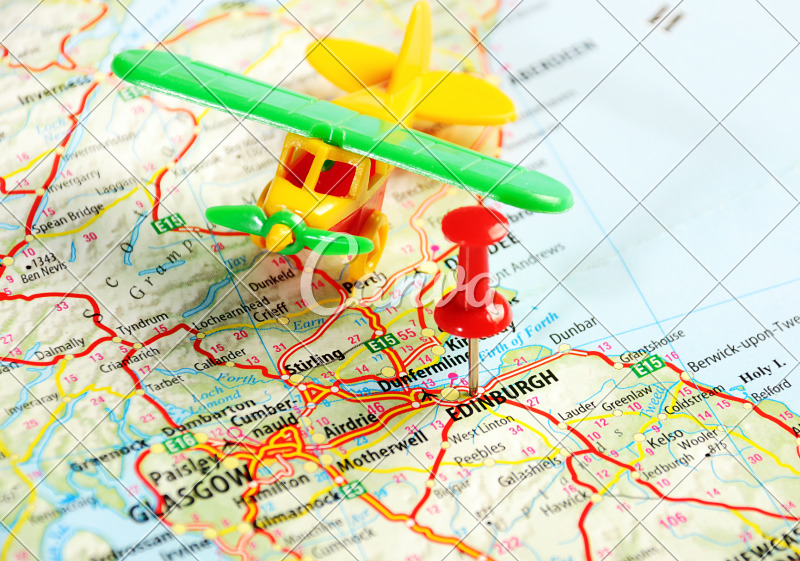 Toy Airplane on a Pinned Map - Photos by Canva