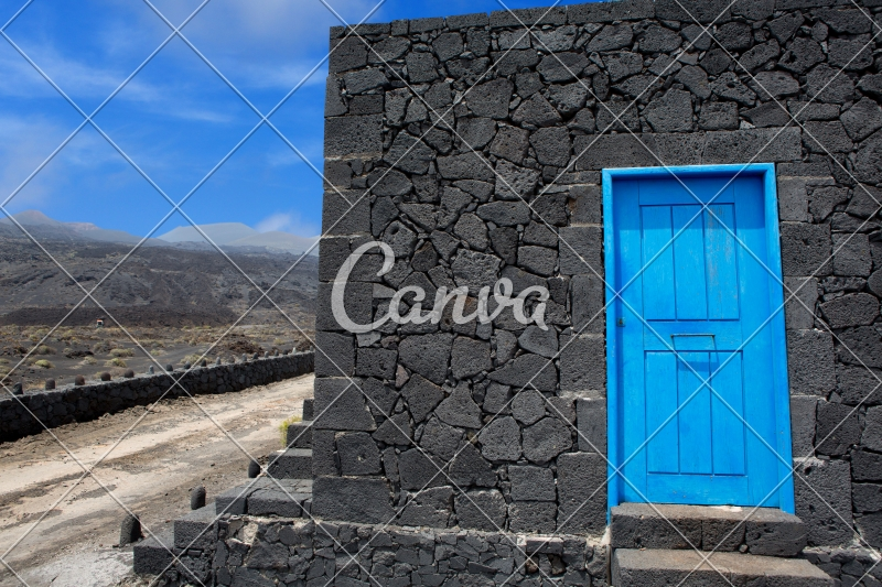 Blue Door Lava Stone Masonry Wall at La Palma - Photos by Canva